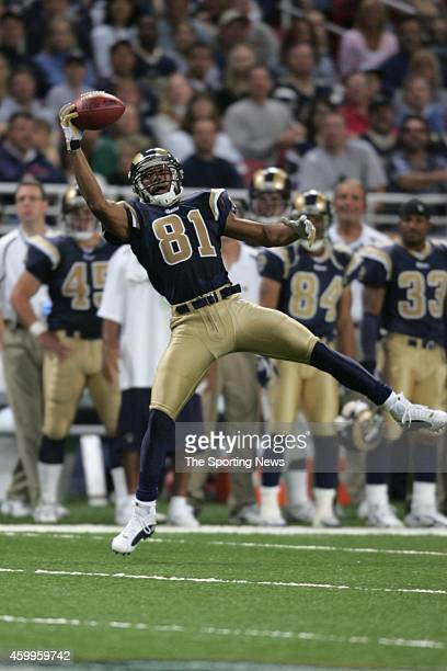 Torry Holt of the St Louis Rams makes a catch during a game against the Seattle Seahawks on October 9 2005 at the Edward Jones Dome stadium in St...