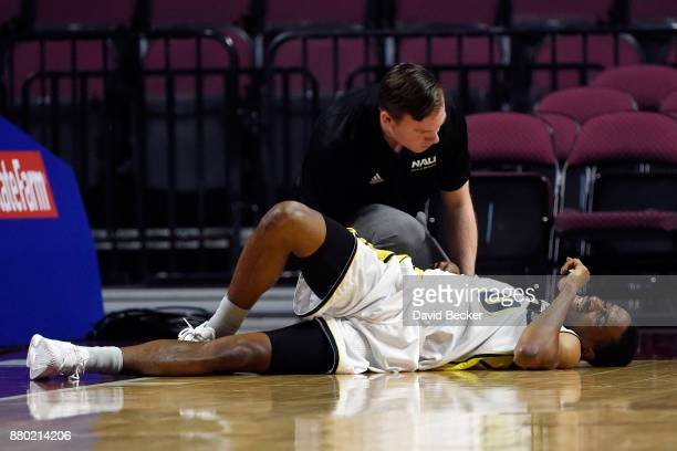 Torry Johnson of the Northern Arizona Lumberjacks is tended to by a trainer after a hard fall against the UC Irvine Anteaters during the 2017...