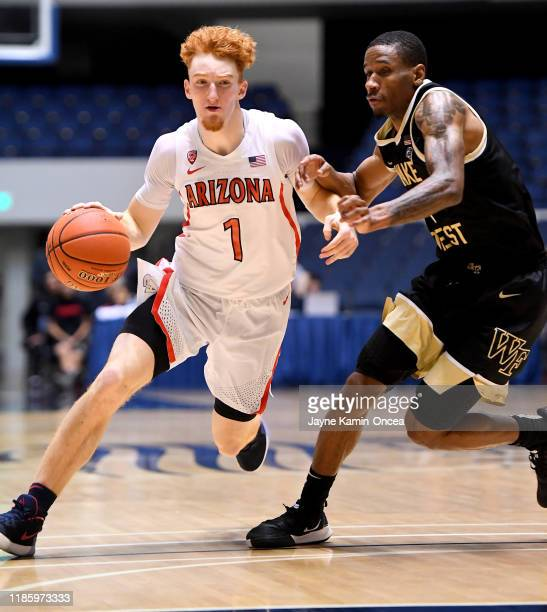 Torry Johnson of the Wake Forest Demon Deacons guards Nico Mannion of the Arizona Wildcats as he takes the ball down court in the second half of the...