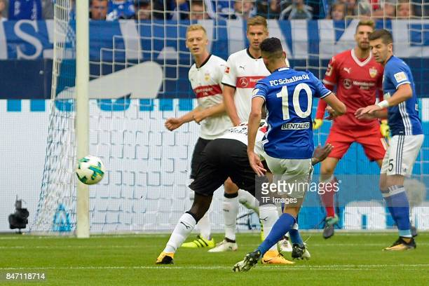 Torschuss durch Nabil Bentaleb of Schalke and Mitte battle for the ball during the Bundesliga match between FC Schalke 04 and VfB Stuttgart at...