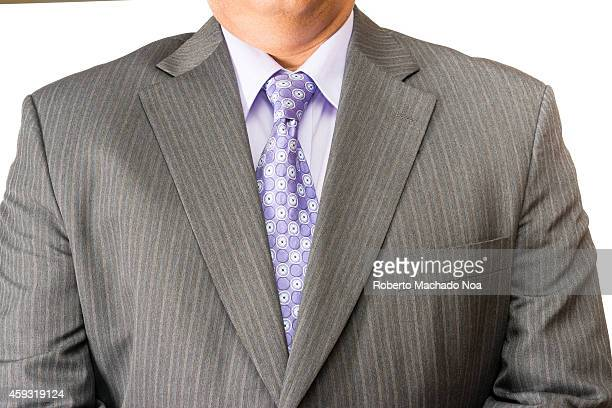 Torso of a business man wearing a suit in an office or service industry