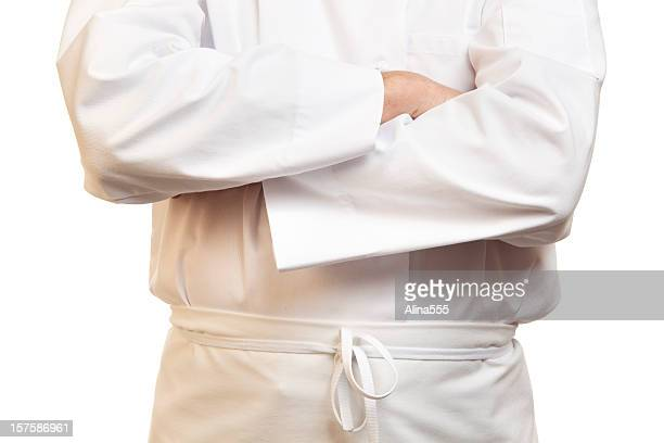 Torso of a cook with crossed arms on white