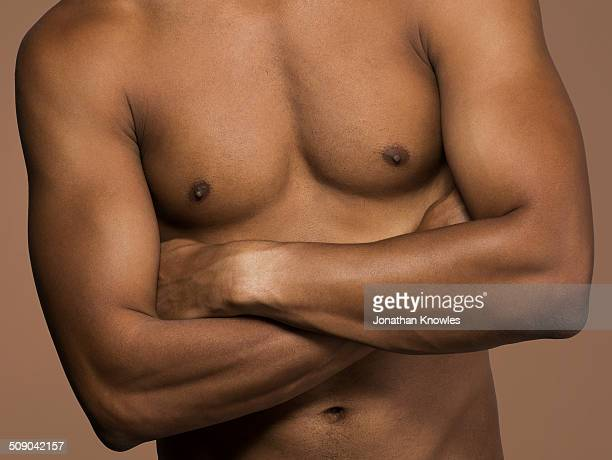 torso of an athletic dark skinned male - birthday suit stock pictures, royalty-free photos & images