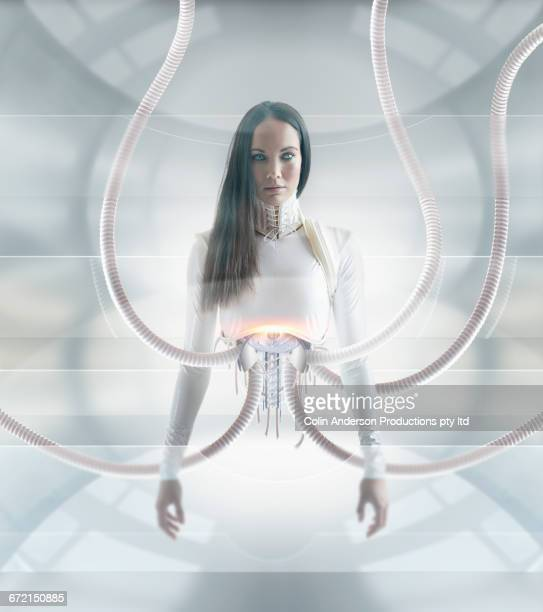 Torso of Futuristic Pacific Islander woman android attached to hoses