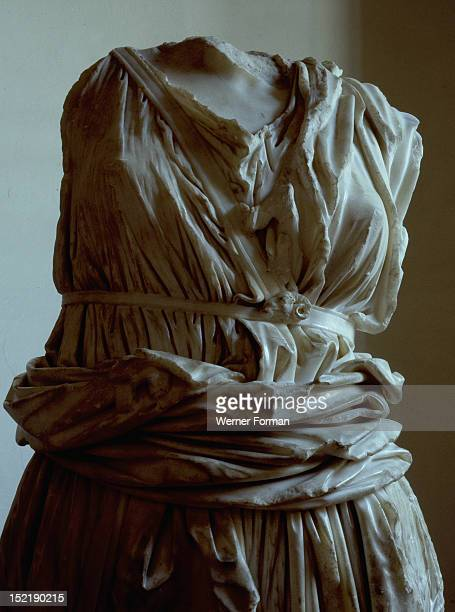 Torso of marble statue from the Capitoline Hill Detail showing a womans under tunic Italy Roman