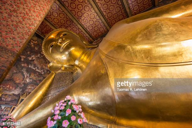 Torso of the famous Reclining Buddha statue at the Wat Pho (Po) temple complex in Bangkok, Thailand.
