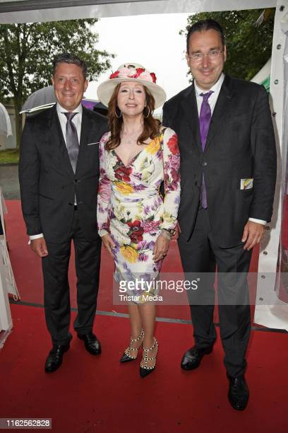 Torsten Bugla Vicky Leandros and Gregor Baum attend the Audi Ascot Race Day at Neue Bult horse racing track on August 18 2019 in Langenhagen Germany