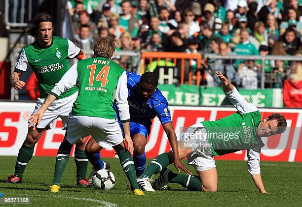 Torsten Frings Aaron Hunt#14 Philipp Bargfrede of Bremen and Cedrick Makiadi of Freiburg compete for the ball during the Bundesliga match between...