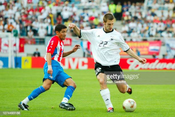 Torsten FRINGS and Denis CANIZA during the FIFA World Cup match between Germany and Paraguay on June 15 2002 in Jeju Stadium South Korea