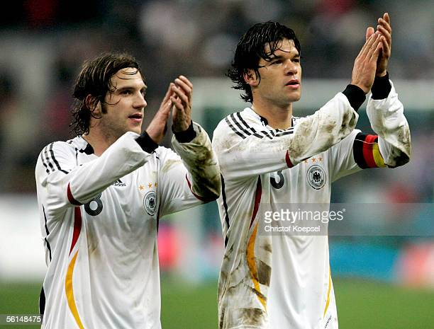 Torsten Frings and Michael Ballack of Germany applaud to the fans after the 00 draw of the international friendly match between France and Germany at...