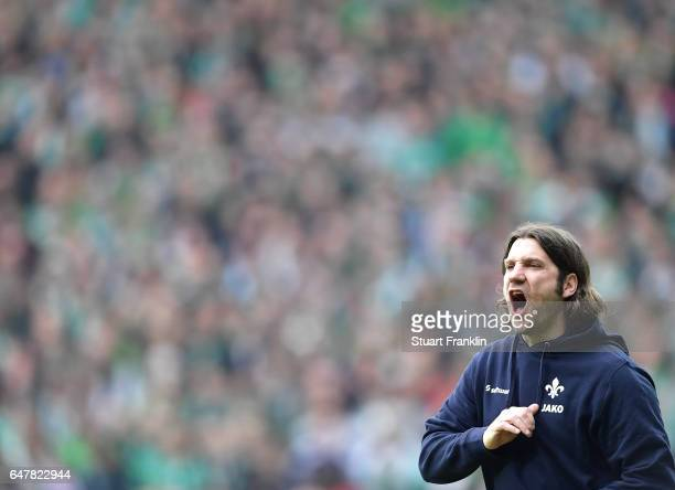 Torsten Frings, head coach of Darmstadt gestures during the Bundesliga match between Werder Bremen and SV Darmstadt 98 at Weserstadion on March 4,...