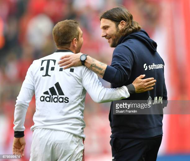 Torsten Frings head coach of Dramstadt talks with Philipp Lahm of Muenchen prior to the Bundesliga match between Bayern Muenchen and SV Darmstadt 98...