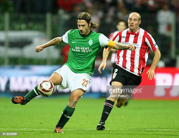 Torsten Frings of Bremen and Gaizka Toquero of Bilbao battle for the ball during the UEFA Europa League Group L match between SV Werder Bremen and...