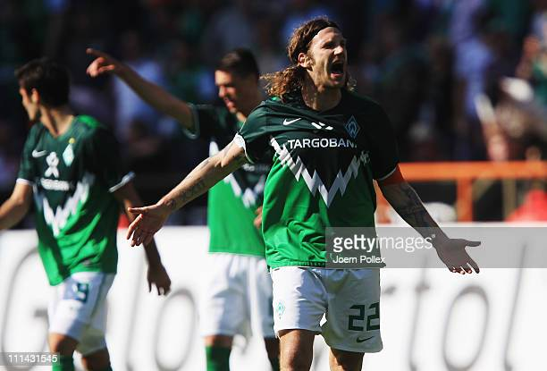 Torsten Frings of Bremen celebrates after scoring his team's first goal during the Bundesliga match between SV Werder Bremen and VfB Stuttgart at...