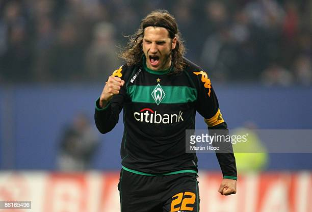 Torsten Frings of Bremen celebrates after scoring the 3rd penalty during the DFB Cup Semi Final match between Hamburger SV and SV Werder Bremen at...