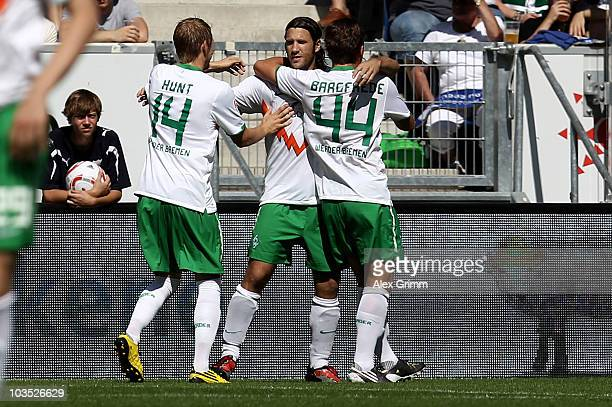 Torsten Frings of Bremen celebrates his team's first goal with team mates Aaron Hunt and Philipp Bargfrede during the Bundesliga match between 1899...