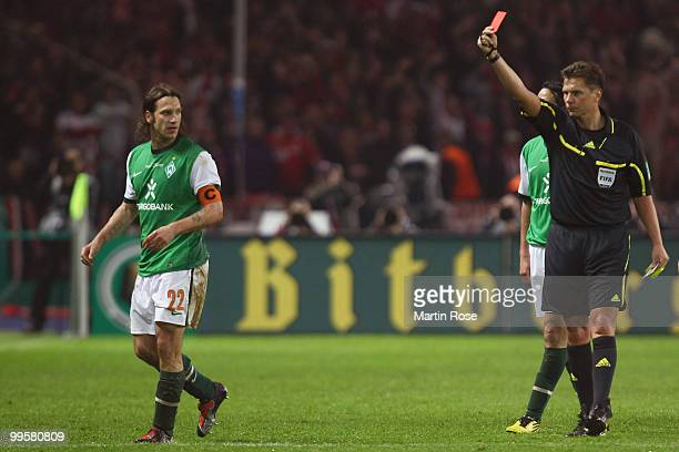 Torsten Frings of Bremen is booked yellow red card by referee Thorsten Kinhoefer during the DFB Cup final match between SV Werder Bremen and FC...