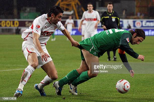 Torsten Frings of Bremen is challenged by Ciprian Marica of Stuttgart during the Bundesliga match between VfB Stuttgart and SV Werder Bremen at the...