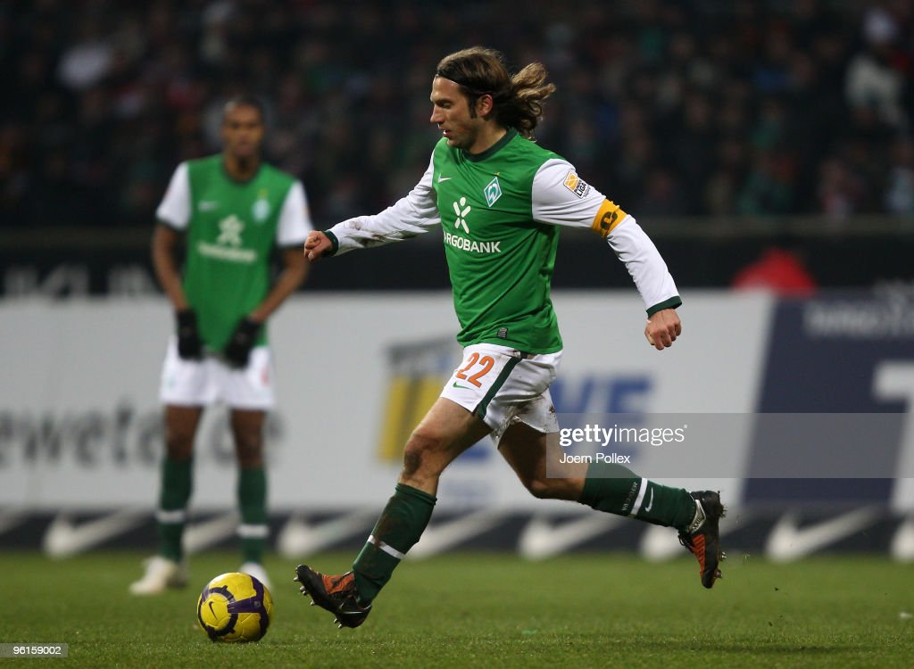 Torsten Frings of Bremen plays the ball during the Bundesliga match between Werder Bremen and FC Bayern Muenchen at Weser Stadium on January 23, 2010 in Bremen, Germany.
