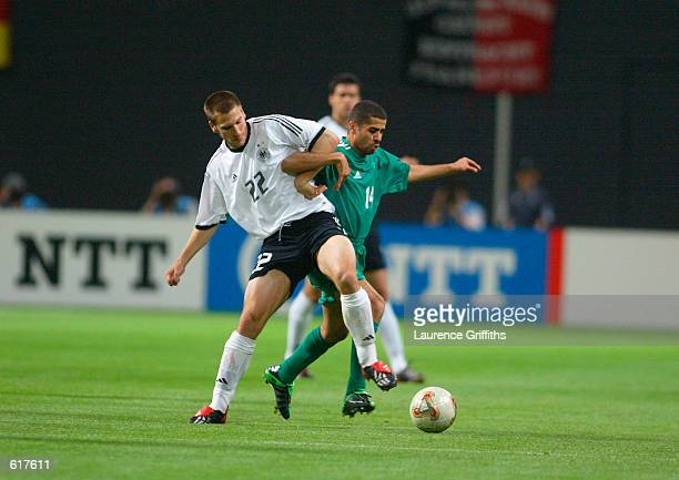 Torsten Frings of Germany and Abdulaziz Khathran of Saudi Arabia during the Germany v Saudi Arabia Group E World Cup Group Stage match played at the...