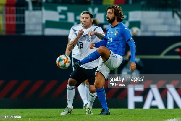 Torsten Frings of Germany and Andrea Pirlo of Italy battle for the ball during the friendly match between DFBAllStars and Azzurri Legends at...