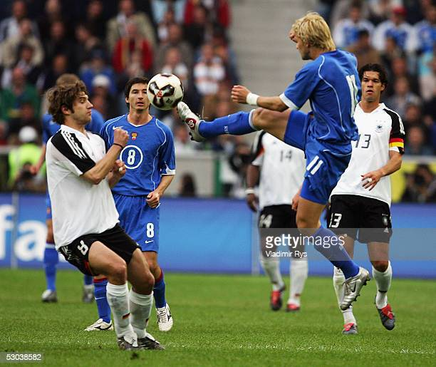 Torsten Frings of Germany and Dmitri Sychev of Russia battle for the ball during the friendly match between Germany and Russia on June 8 2005 in...
