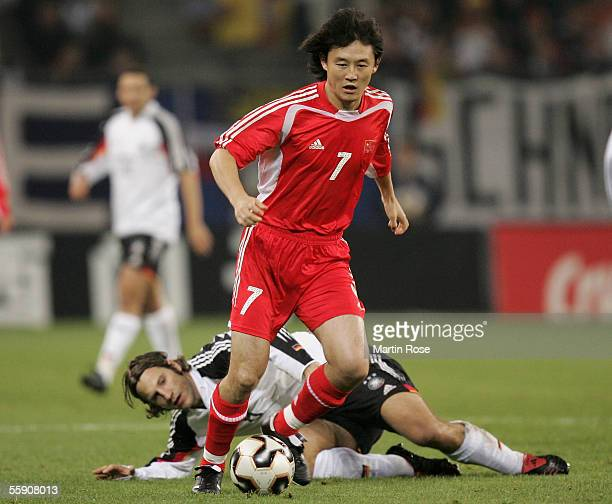 Torsten Frings of Germany and Jihai Sun of China fight for the ball during the friendly game between Germany and China at the AOL Arena on October...