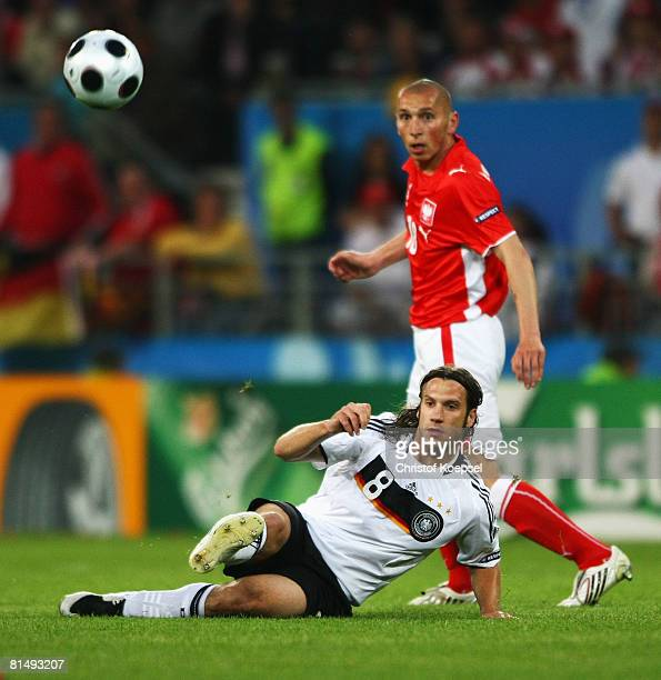 Torsten Frings of Germany in action while Mariusz Lewandowski of Poland looks on during the UEFA EURO 2008 Group B match between Germany and Poland...