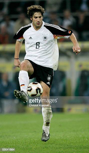 Torsten Frings of Germany runs with the ball during the friendly match between Germany and Russia on June 8 2005 in Monchengladbach Germany