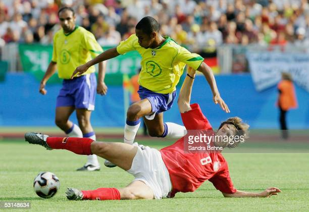 Torsten Frings of Germany tackles Robinho of Brazil during the FIFA Confederations Cup Semi Final match between Germany and Brazil on June 25, 2005...