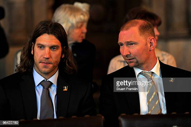 Torsten Frings of Werder Bremen and former player Dieter Eilts look on during the celebration of the 111th year of SV Werder Bremen at the town hall...