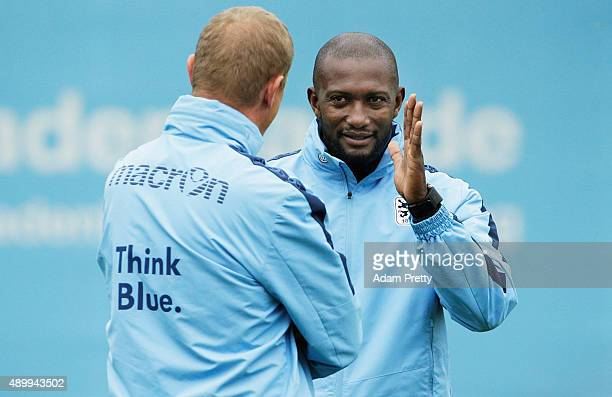 Torsten Froehling head coach and Collin Benjamin assistant coach of 1860 Muenchen watch the team train during training at 1860 Muenchen training...
