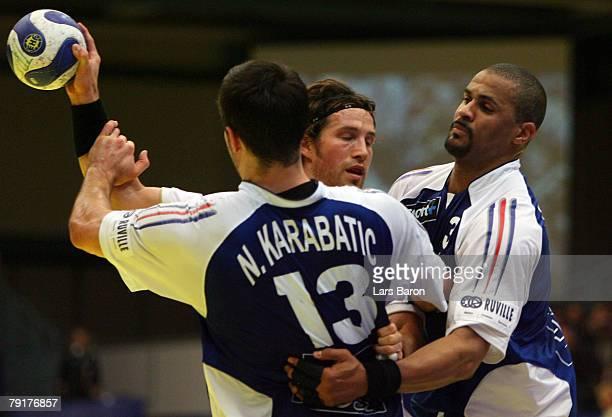 Torsten Jansen of Germany in action with Nikola Karabatic and Didier Dinart of France during the Men's Handball European Championship main round...
