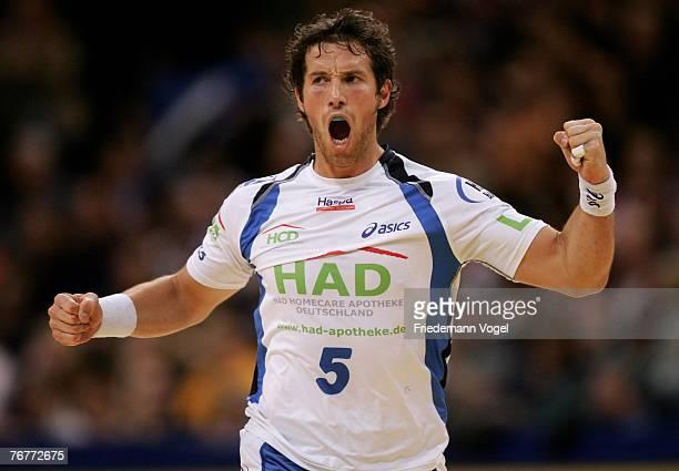 Torsten Jansen of Hamburg celebrates during the Bundesliga Handball match between HSV Hamburg and RheinNeckar Loewen at the Colorline Arena on...