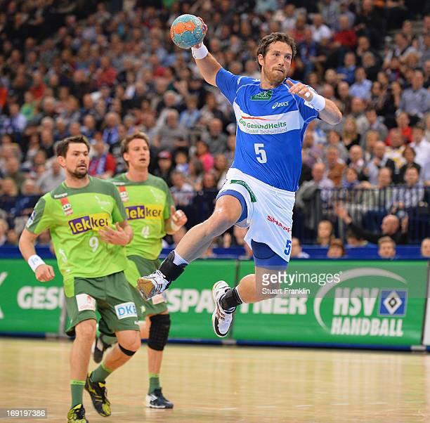 Torsten Jansen of Hamburg throws a goal during the DKB Bundeliga match between HSV Hamburg and Fuechse Berlin at O2 World on May 21 2013 in Hamburg...