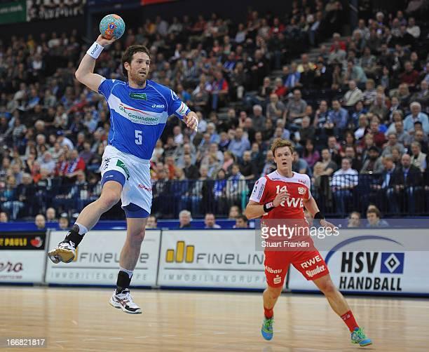 Torsten Jansen of Hamburg throws a goal during the DKB Bundesliga handball game between HSV Hamburg and TUSEM Essen at O2 World on April 17 2013 in...