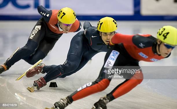 Torsten Kroeger of Germany Apolo Anton Ohno of the United States and Daan Breeuwsma lean into a corner during their 1000m heat at the ISU World Cup...