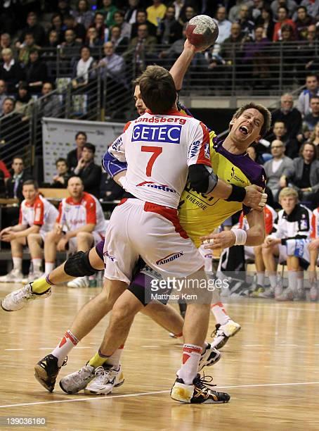Torsten Laen of Berlin is attacked by Kjell Landsberg of Magdeburg during the Toyota Handball Bundesliga match between Fuechse Berlin and SC...