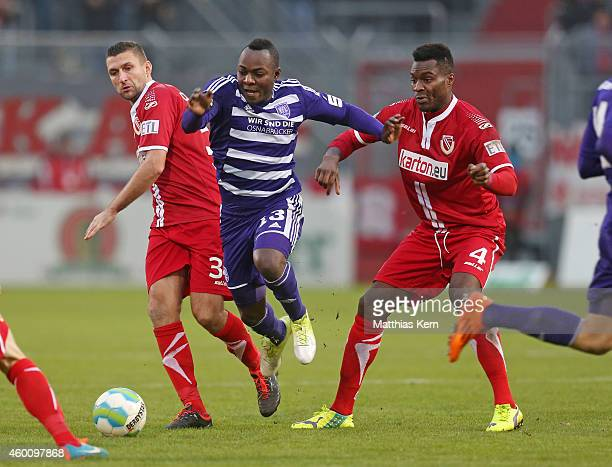 Torsten Mattuschka, Addy Waku Menga and Ebewa Yam Mimbala battle for the ball during the third league match between FC Energie Cottbus and VFL...