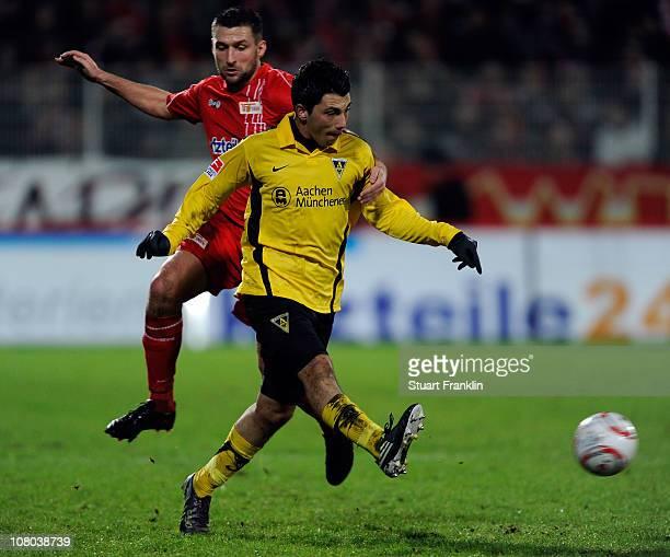 Torsten Mattuschka of Berlin challenges Tolgay Arslan of Aachen during the Second Bundesliga match between Union Berlin and Alemannia Aachen at Alte...