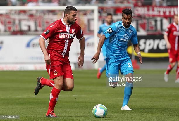Torsten Mattuschka of Cottbus battles for the ball with Royal Dominique Fennell of Stuttgart during the third league match between FC Energie Cottbus...