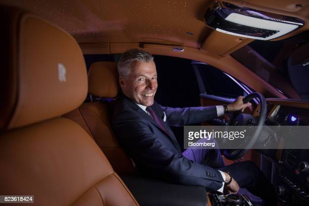 Torsten MuellerOetvoes chief executive officer of RollsRoyce Motor Cars Ltd poses for a photograph during a media preview of the unveiling of the new...