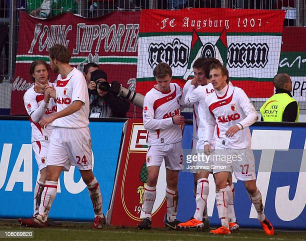 Torsten Oehrl of Augsburg celebrates with his teammates after scoring his teams first goal during the Second Bundesliga match between FC Augsburg v...