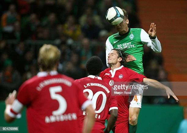 Torsten Oehrl of Bremen heads his team's third goal during the DFB Cup round of 16 match between between Werder Bremen and 1 FC Kaiserslautern at the...