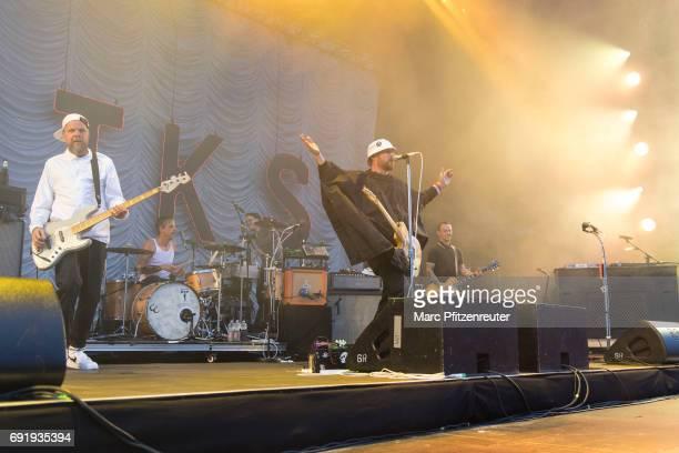 Torsten Scholz Thomas Goetz Arnim TeutoburgWeiss and Bernd Kurtzke of Beatsteaks perform on stage during the second day of 'Rock am Ring' on June 3...