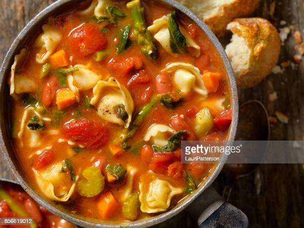 tortellini and vegetable soup - vegetable soup stock pictures, royalty-free photos & images