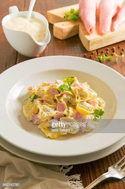 Tortellini with ham and cream sauce