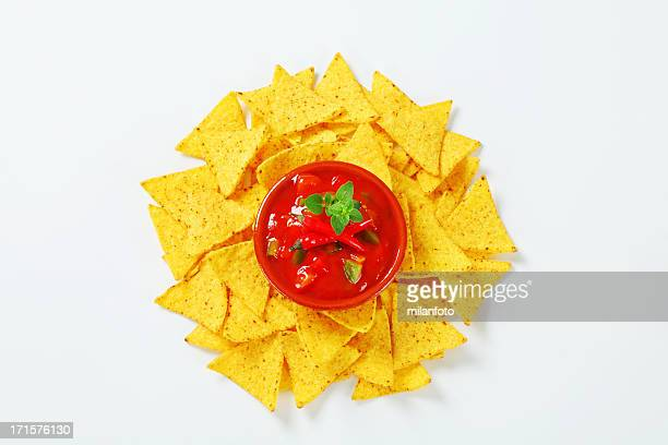tortilla chips with salsa souce - nachos stock photos and pictures