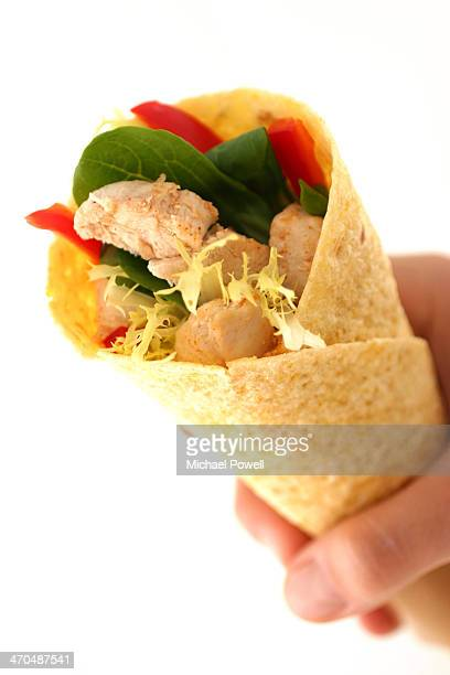 Tortilla wrap being held