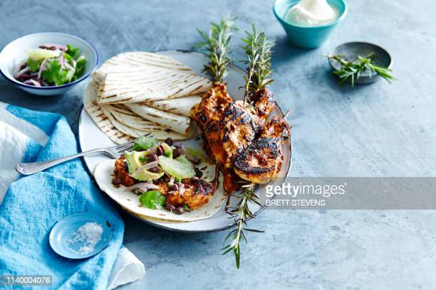 tortilla wraps with bbq chipotle chicken and blackbean salsa - tortilla flatbread stock pictures, royalty-free photos & images